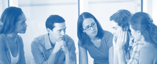 group of people listening to a sharer concept